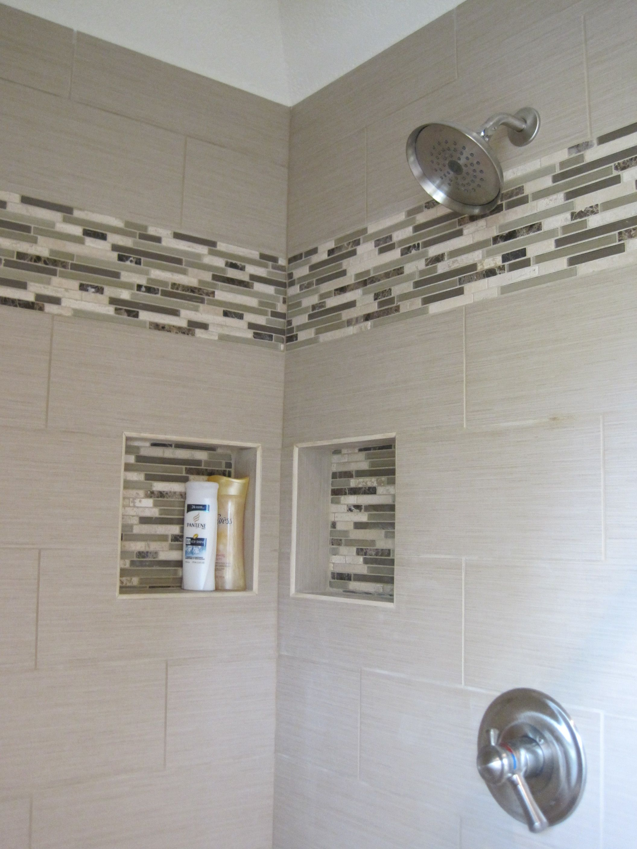Linen tile with glass linear mosaics to accent the shower space ...