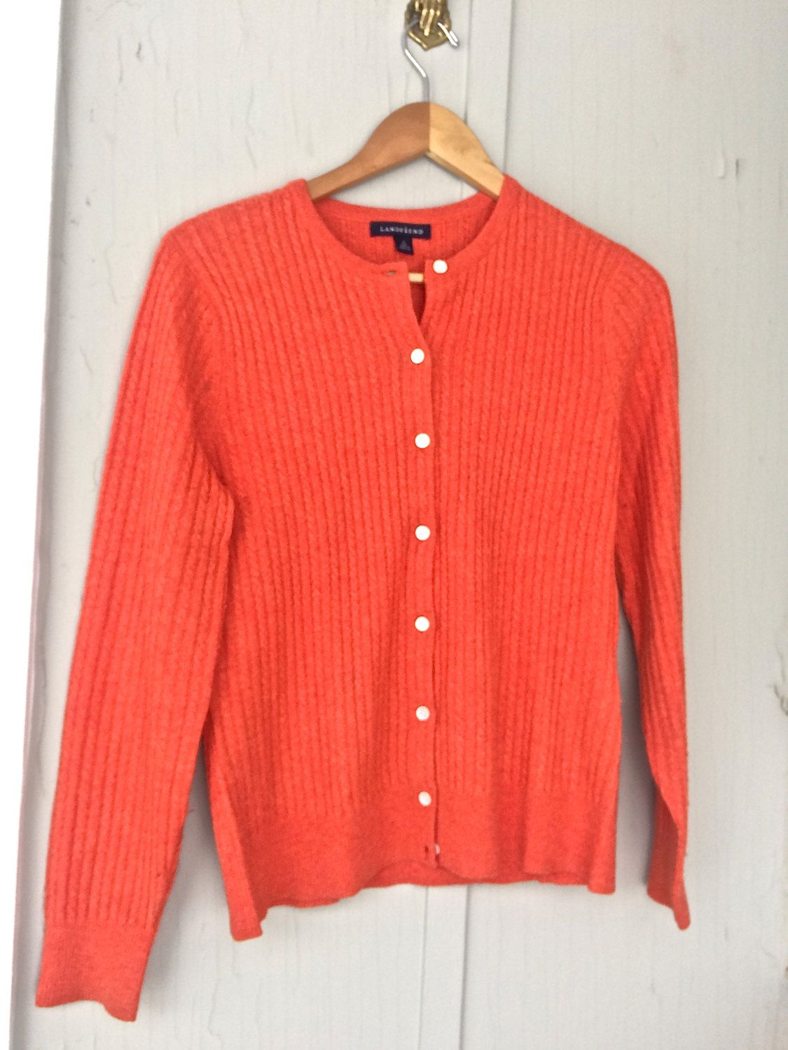 This warm and toasty orange cashmere crew neck cardigan is a great ...
