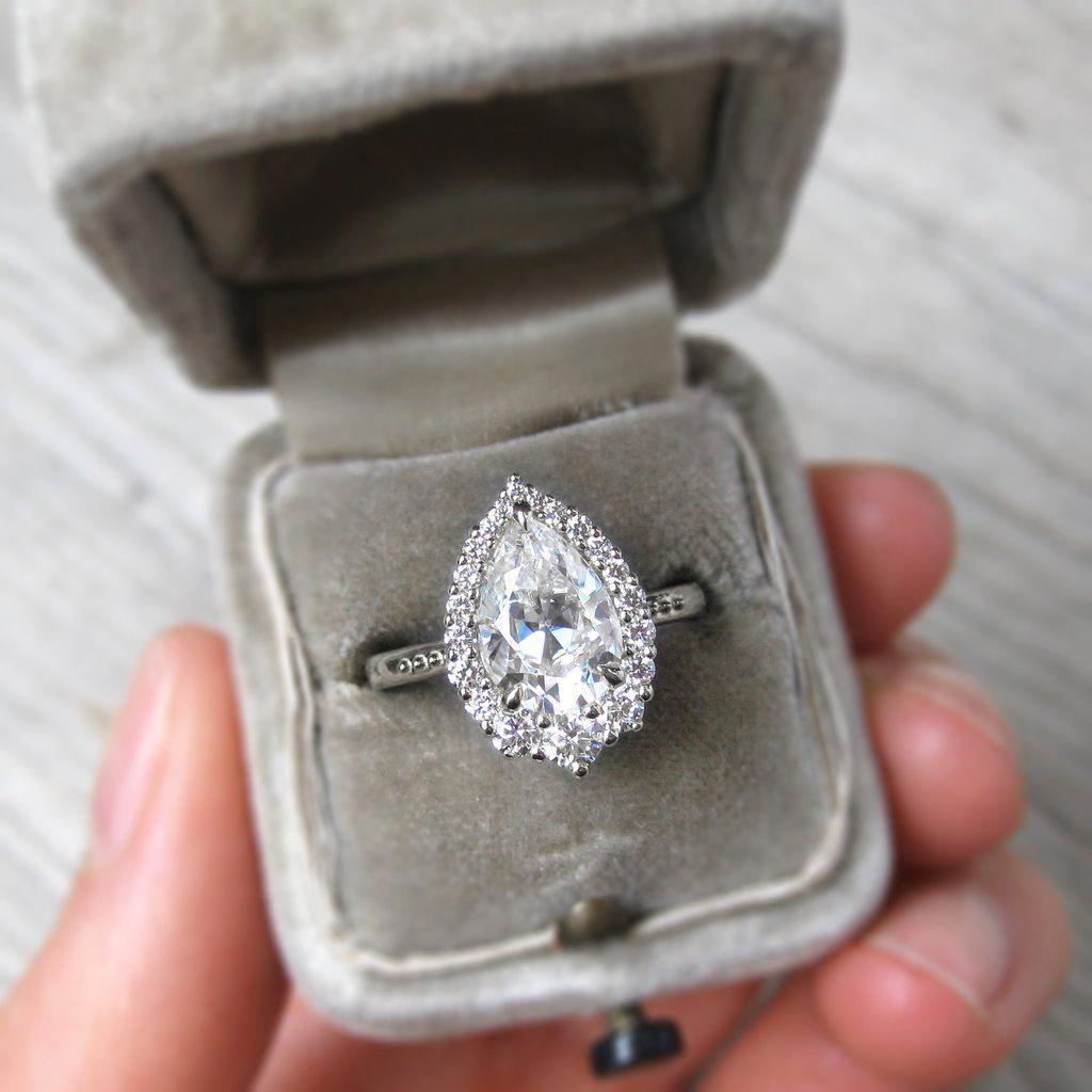 Pear cut moissanite ring in platinum conflictfree