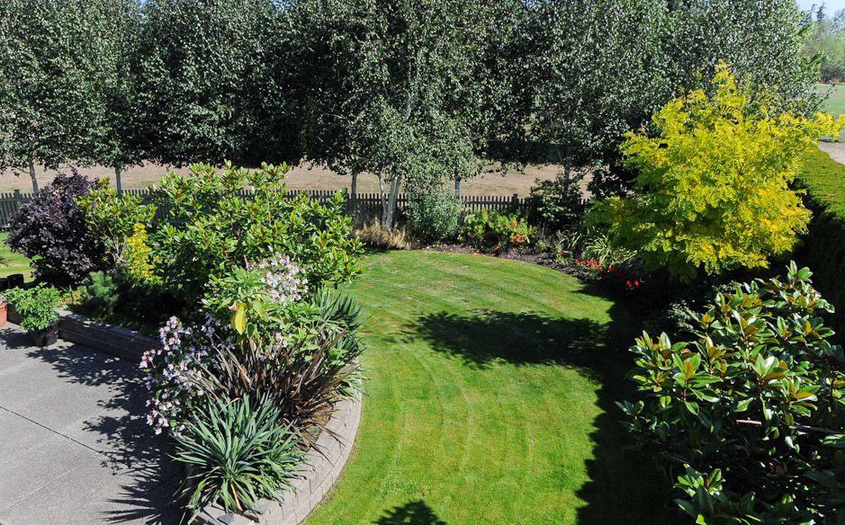 Lush Gardens at Crown Isle Fairway Home for Sale Lush