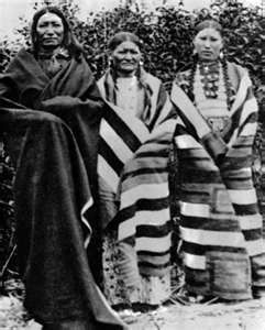 Chief Spotted Tail with his wife and daughter.