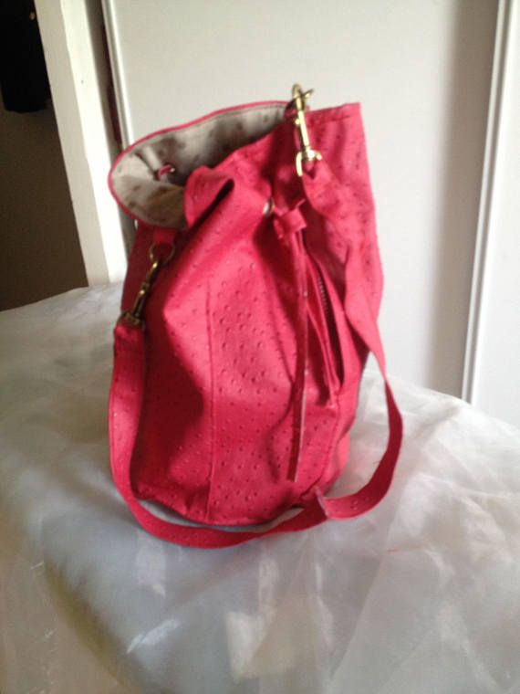 Red simli bag leather Color bronze, Lobster clasp and Cord