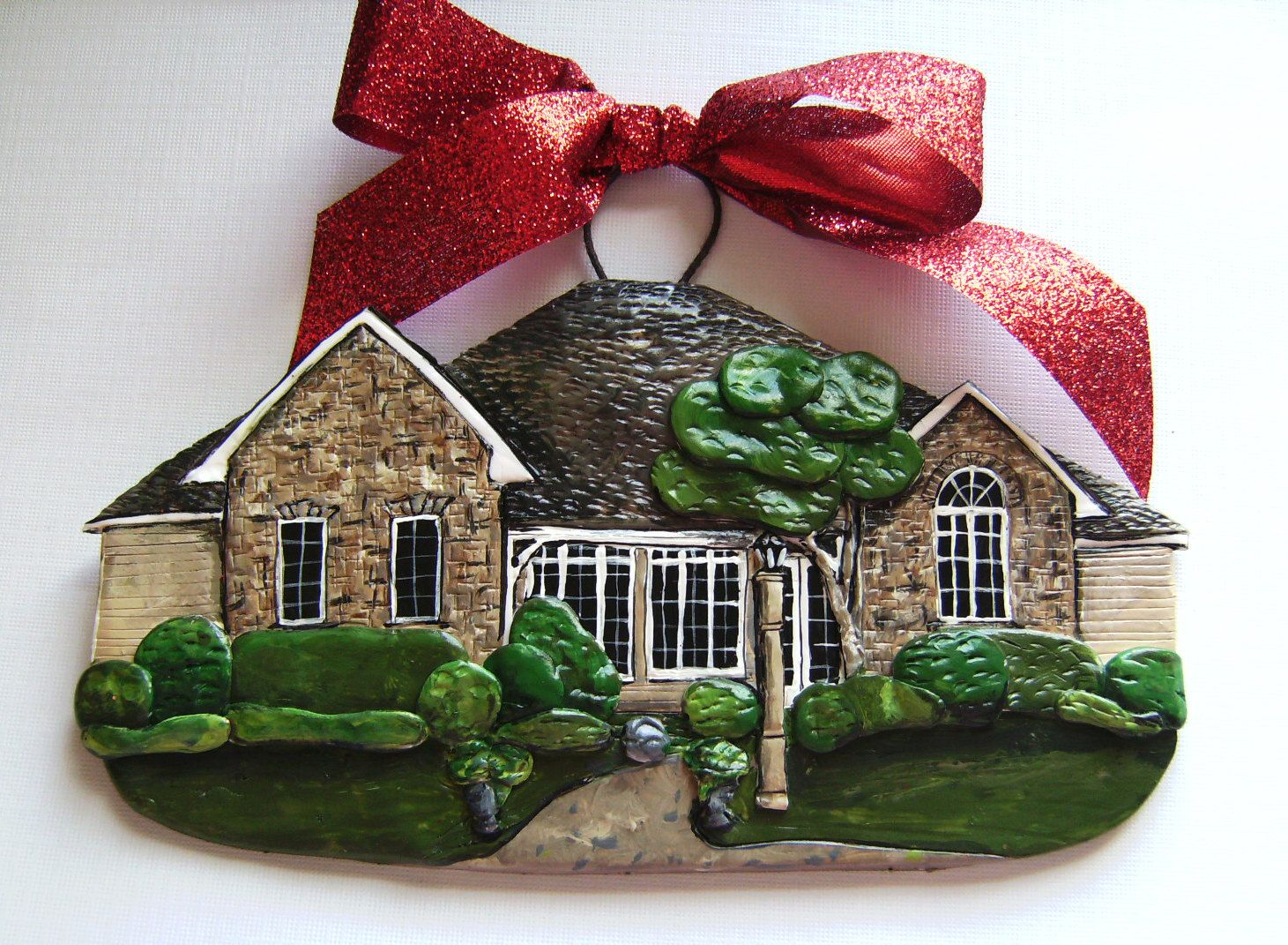 This is so cool! You can actually order an ornament made to look exactly like your house!this would be good to have of ur first house
