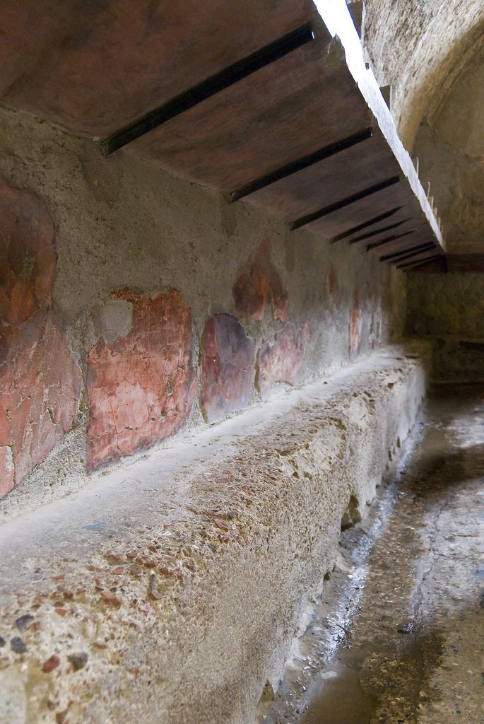 Herculaneum, Italy - This is the interior of a Roman Bath. The colors and details of the walls and floor are well preserved.