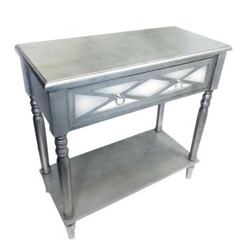 Have a glance at the chic table that will certainly lend your house classy appeal. This table is rectangular and made from quality wood. The legs of it have intricate swirl design, which adds charming appeal to it. This table has silver-gray color finish that generally compliments range of home interior. It can be part of range of home interiors. Adorn this table in your living room, bedroom or guests area. This table with TV on it will look stunning in your drawing room. It has enough space to