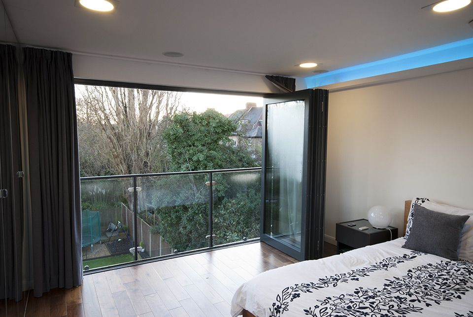 Glass Ballustrade And Sliding Glass Doors Loft Conversion Bedroom Loft Conversion Loft Room