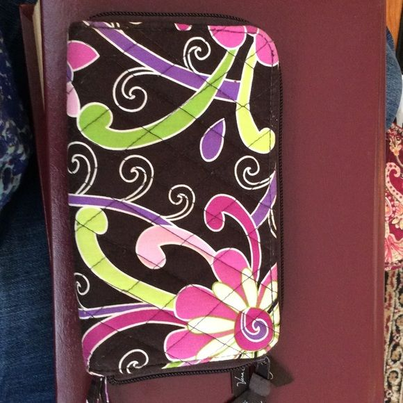 Vera Bradley zipper wallet Cute wallet with cc slots for all your needs . License area is darker so please look at pics. Smoke/pet free home Vera Bradley Bags Wallets