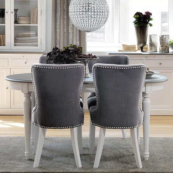 Victoria Distressed White Extending Oval Dining Table With Upholstered Grey Chairs