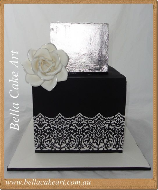 Two tier Black White and silver wedding cake by Bella Cake Art