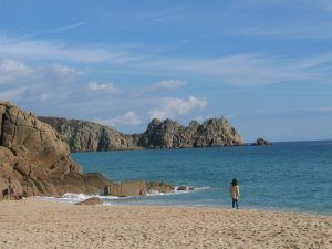 A walker on the sands of porthcurno in West Cornwall http://ednoveanfarm.co.uk/blog/porthcurno-beach-is-simply-beautiful/
