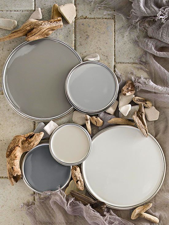 Warm Gray Paint Colors - Top left: Benjamin Moore Winter Gates AC-30; top right Ace Hardware Coastal Pleasure 5048; middle True Value Paint Promotion 10D3; bottom left Glidden Seal Gray GLN46; bottom right Behr Silver Drop 790C2.