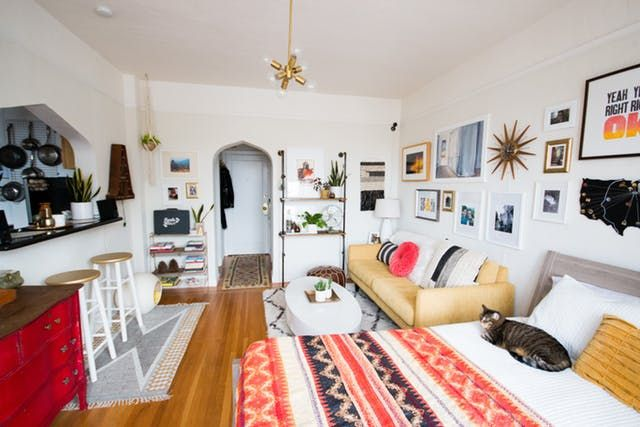 How To Make A Studio Apartment Feel Bigger Than It Is First Apartment Decorating Apartment Decor Apartment Layout