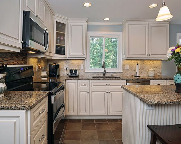 5 Most Popular Kitchen Cabinet Colors And Styles Kitchen Cabinets With Black Appliances Black Appliances Kitchen Kitchen Remodel