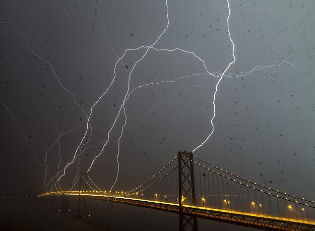 The Bay Bridge is bombarded with some of the 750 lightning strikes that hit the Bay Area during Thursday's storm.