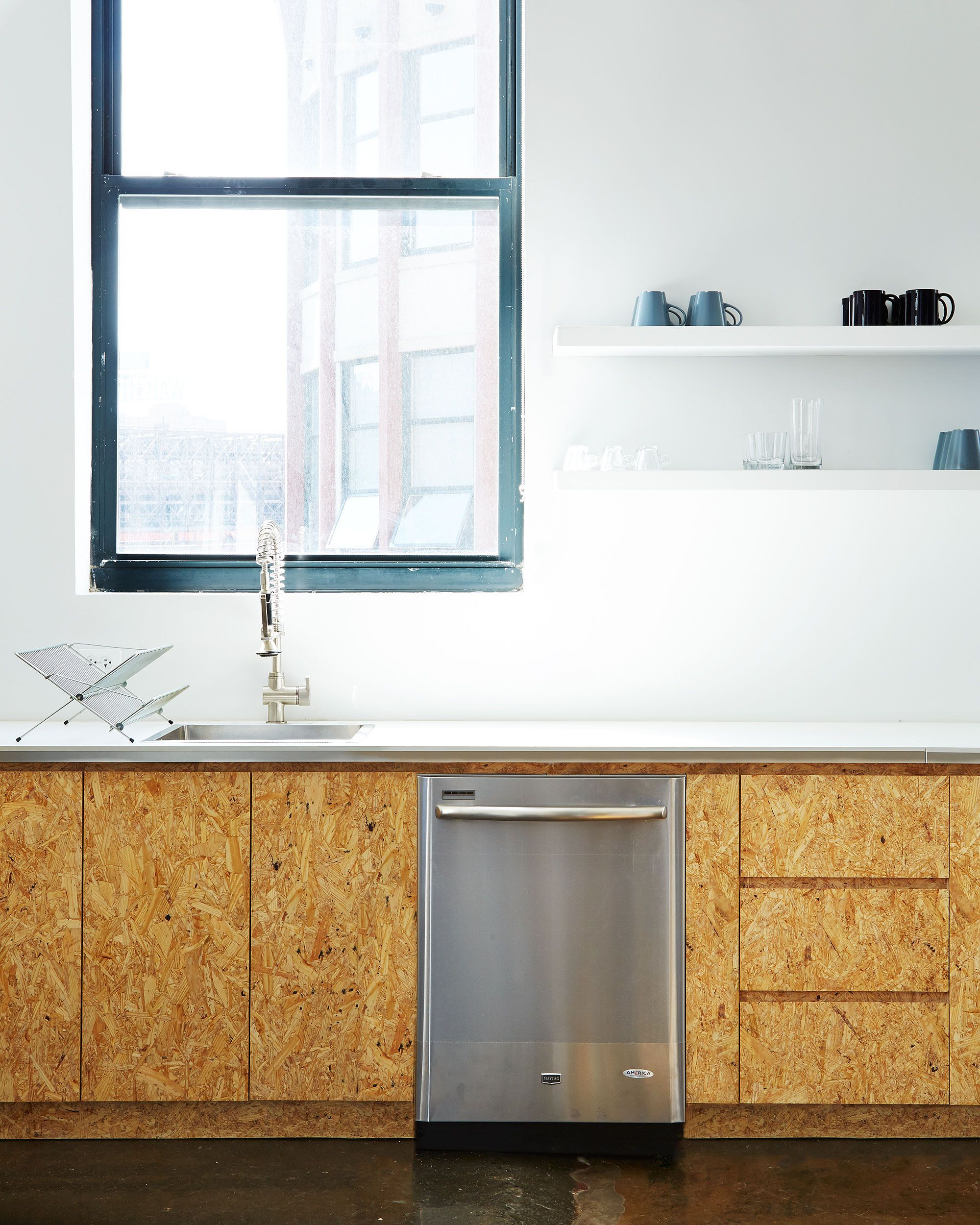 Kitchen Of The Week The Stylishly Economical Kitchen Chipboard Edition Remodelista Replacing Kitchen Countertops White Countertops Kitchen Design