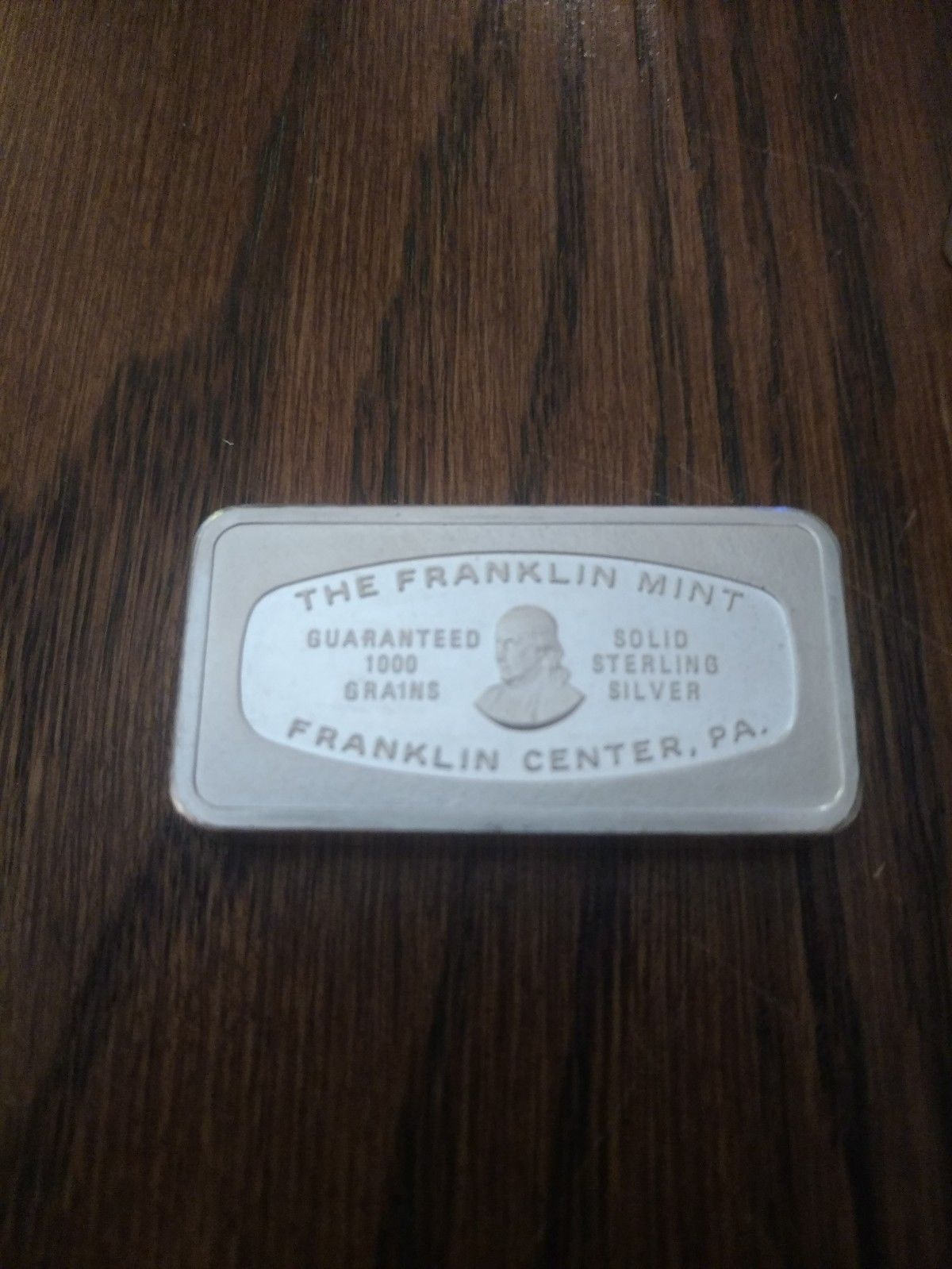 The Franklin Mint Guaranteed 1000 Grains 925 Sterling Silver Bar