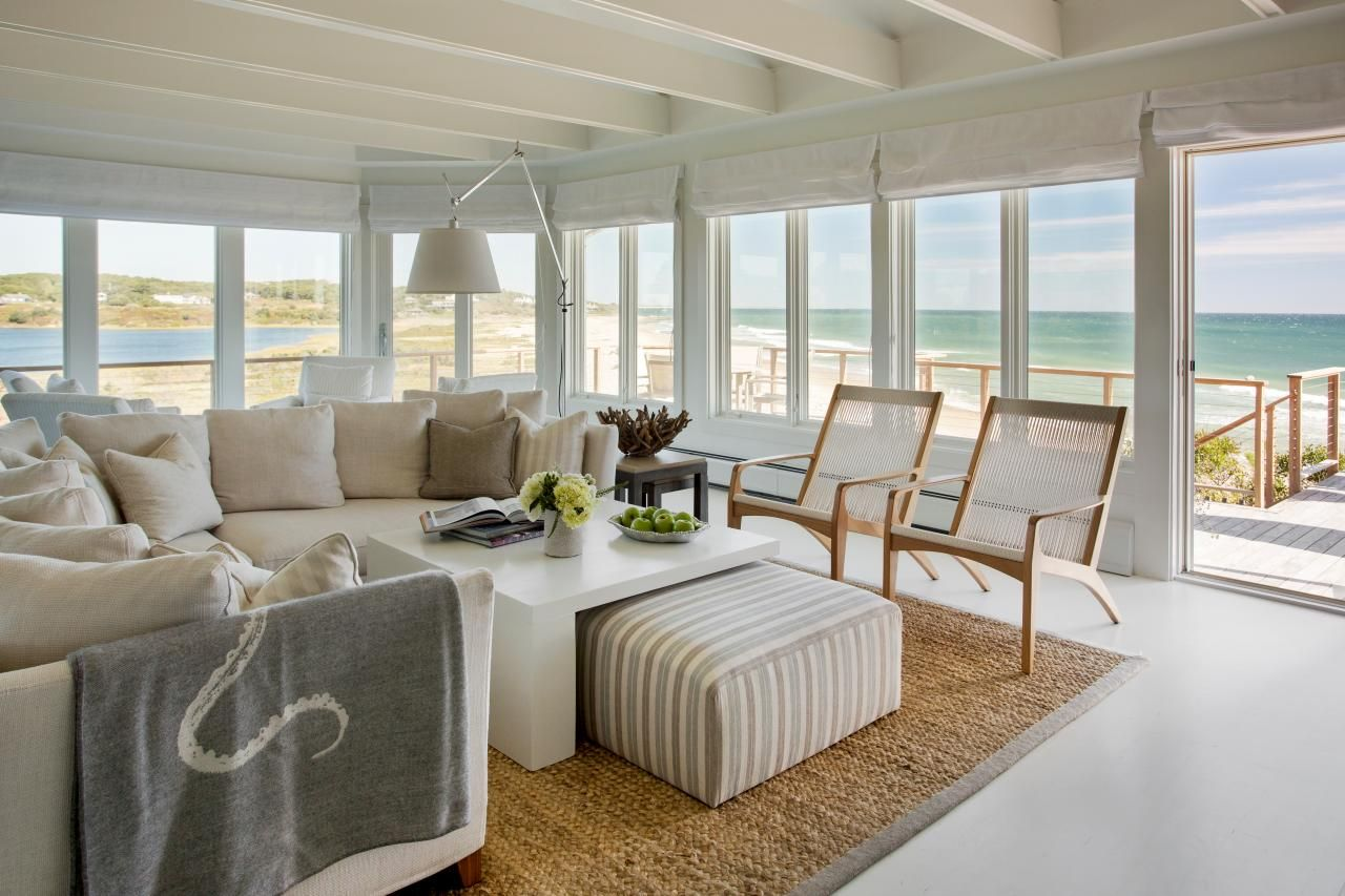 Relaxed coastal living room overlooks marthas vineyard the large open living room is full of windows that allow natural light to pour into the space