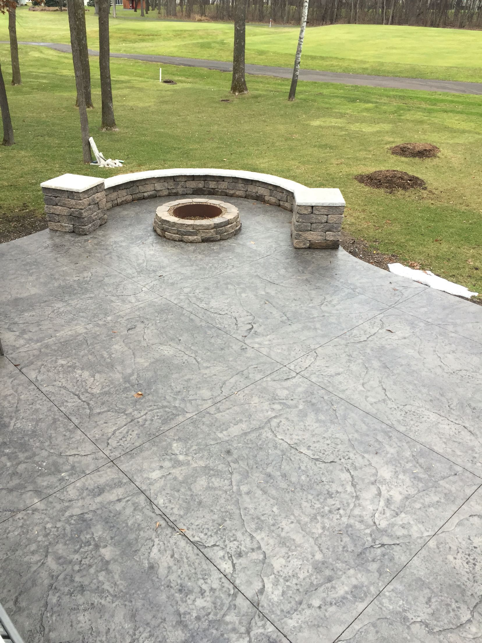 Stamped Concrete Patio With Integrated Seating Wall Pillars And Matching Fire Pit By Sierra Concret In 2020 Concrete Patio Stamped Concrete Patio Fire Pit Landscaping