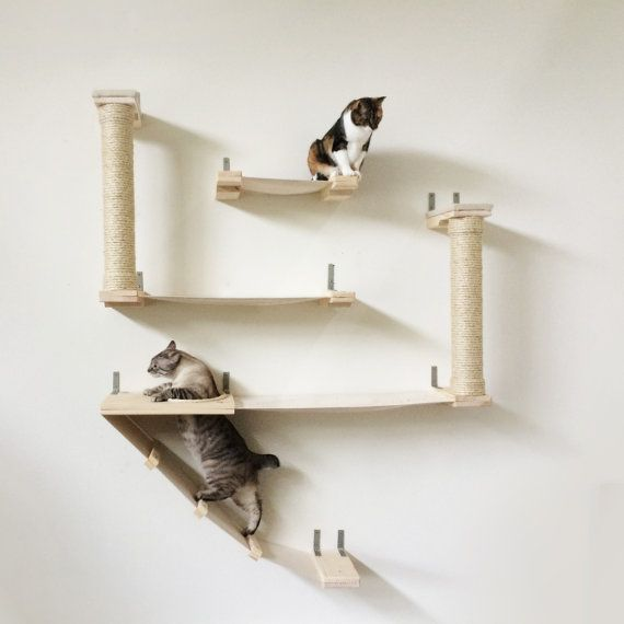 the roman cat fort   handcrafted sisal canvas and wood cat tree wall mounted shelving the roman cat fort cat hammock shelves por catastrophicreations      rh   pinterest