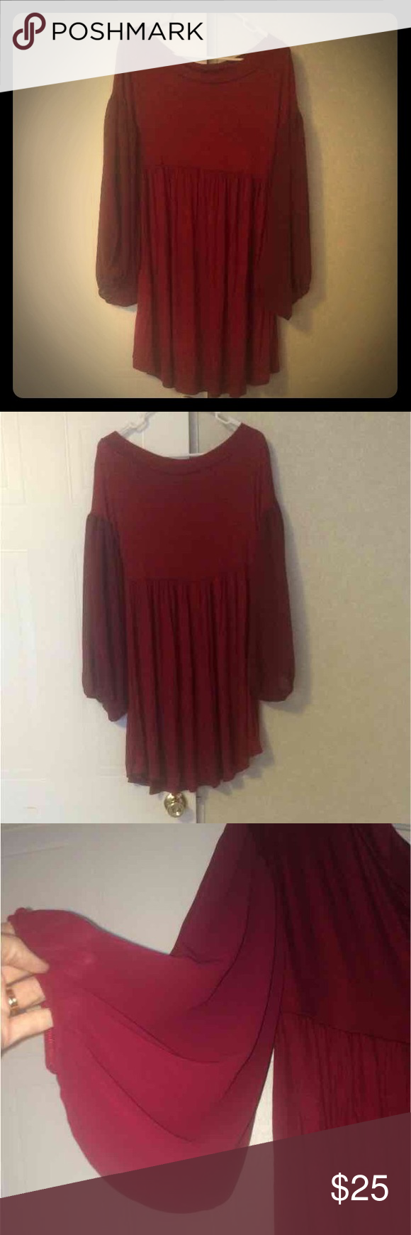 Crimson dress NWOT I bought this dress for my daughter and it didn't fit her. It doesn't have the tags but it was only tried on and never worn. It is a women's small. Has sheer sleeves. Dresses Midi