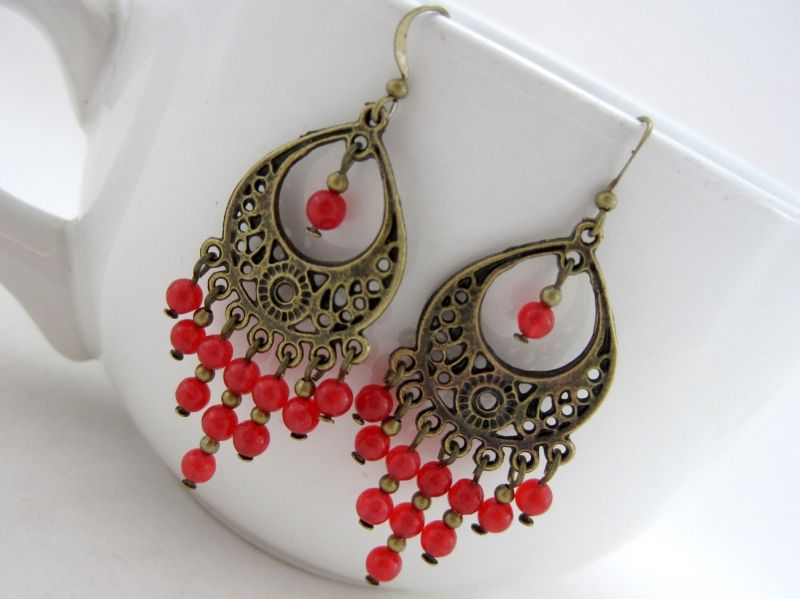 All Fired Up Chandelier Earrings $14.00 - Red raw ruby beads, and bronze plated Tibet silver are combined together for a stylish look. The earrings are strung onto bronze plated wire for strength, durability and drape.
