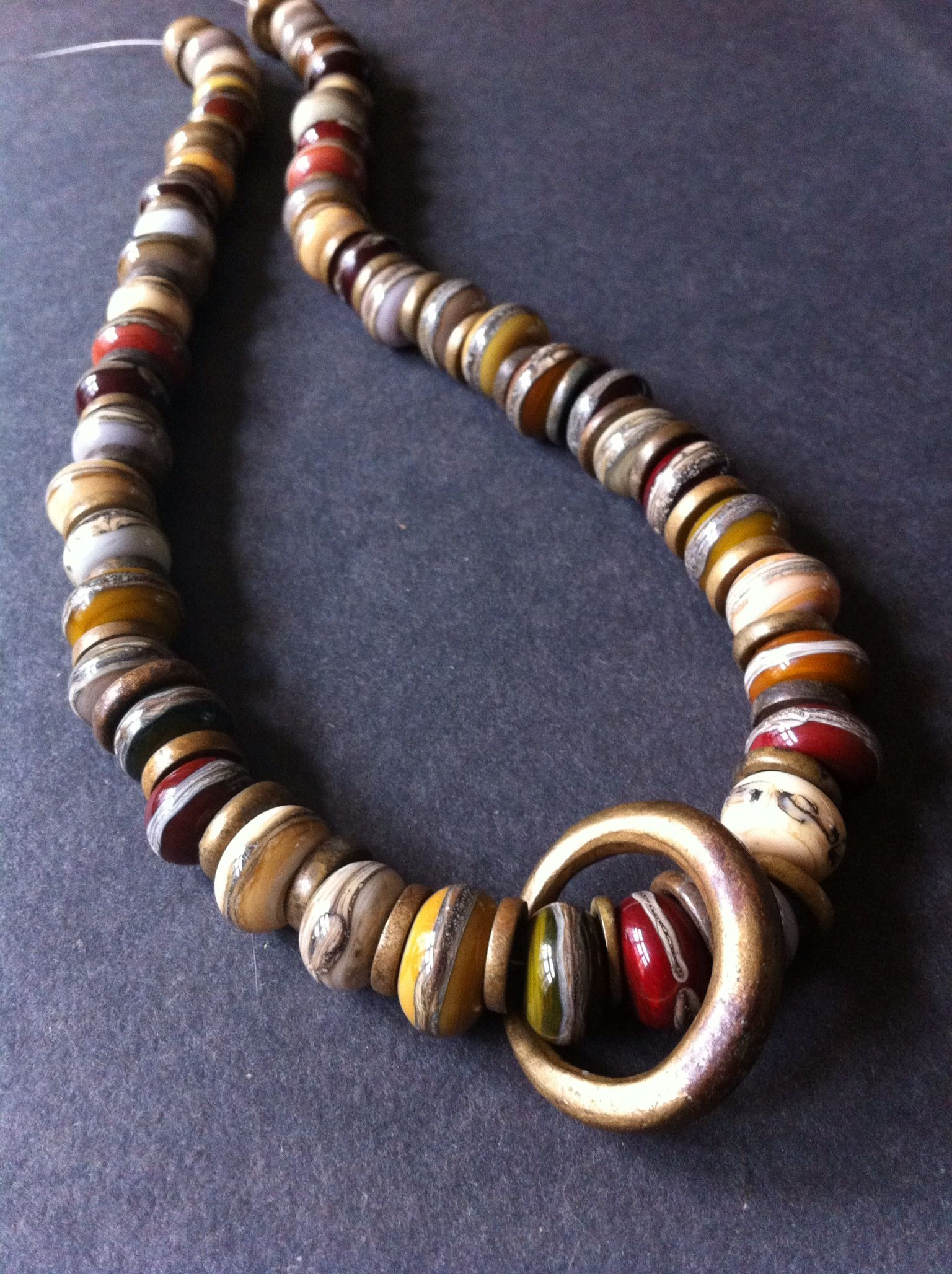 Brown, grey, maroon beads combined with old African brass rings