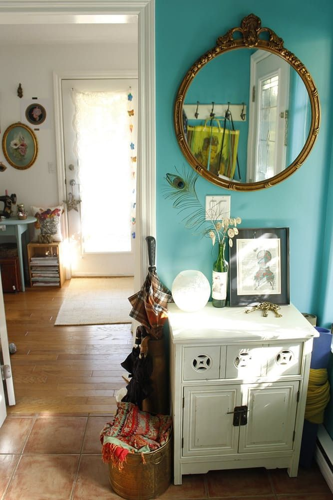 From apartment therapy - LOVE the wall color...and the mirror!