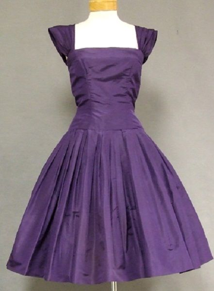 1950's silk taffeta cocktail party dress, with fitted elongated bodice, square neckline, and full skirt with an attached crinoline. By Mollie Parnis, New York.