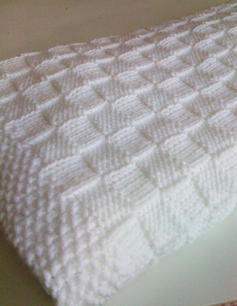Photo of the knit baby blanket…