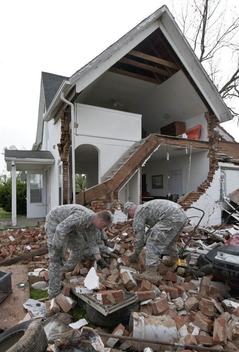 Iowa Army National Guard Soldiers help the cleanup in