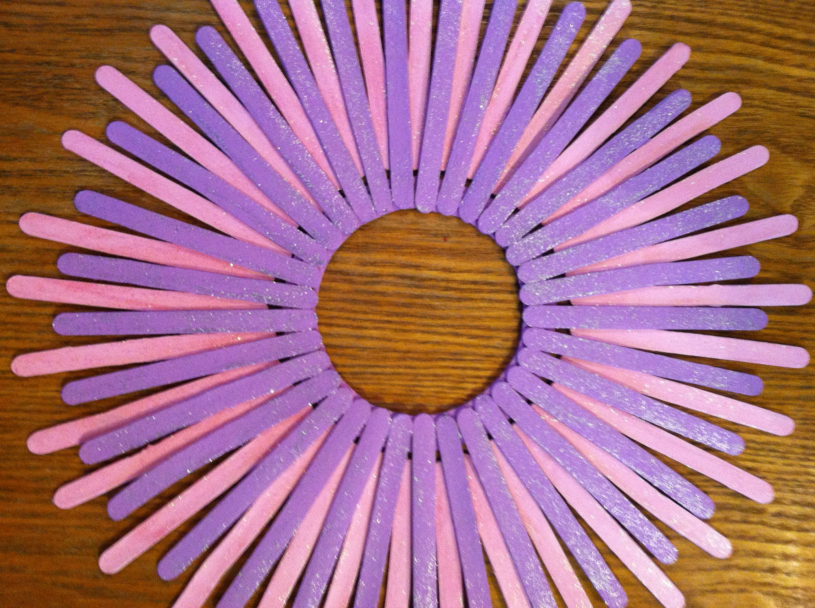 Popsicle stick wreath sticks can be painted many colors and glitter