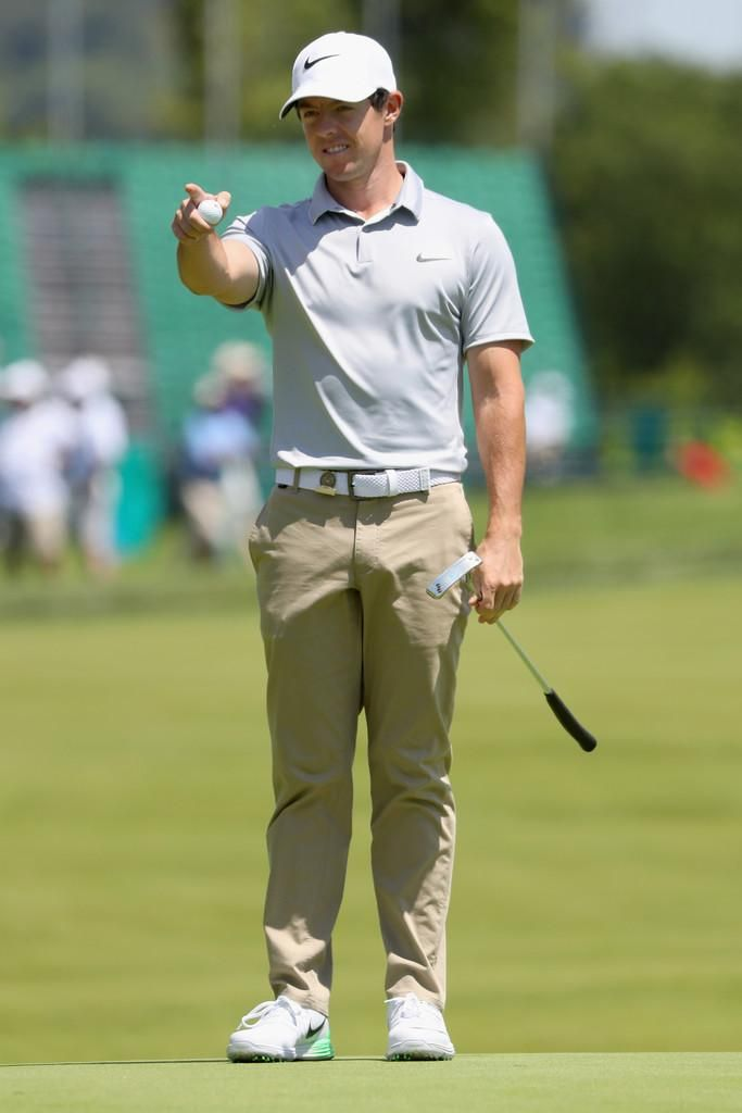 Rory McIlroy wearing Nike Legacy 91 Tour Golf Hat, Nike Stretch Woven Belt  in White, Nike Modern Fit Washed Golf Pants in Khaki, Nike MM Fly Swing  Knit Golf ...