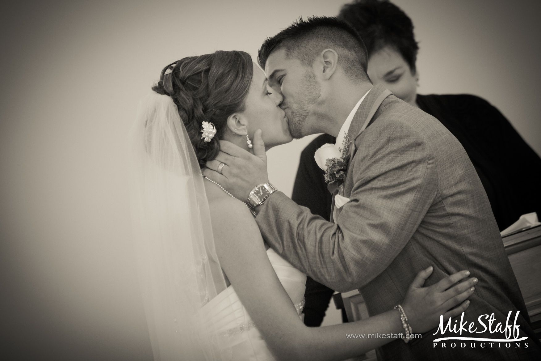 You may now kiss the bride - in front of all your friends and family. Tips for discussing your first kiss.  #WeddingPlanning #MikeStaffProductions