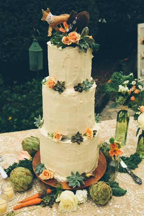 Our very tall humming bird wedding cake with succulents and flowers ...