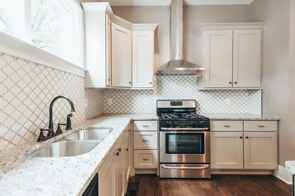 White kitchen cabinets with arabesque backsplash tile