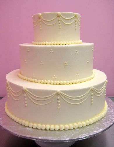 Traditional Buttercream Piped Wedding Cake Swag Dot