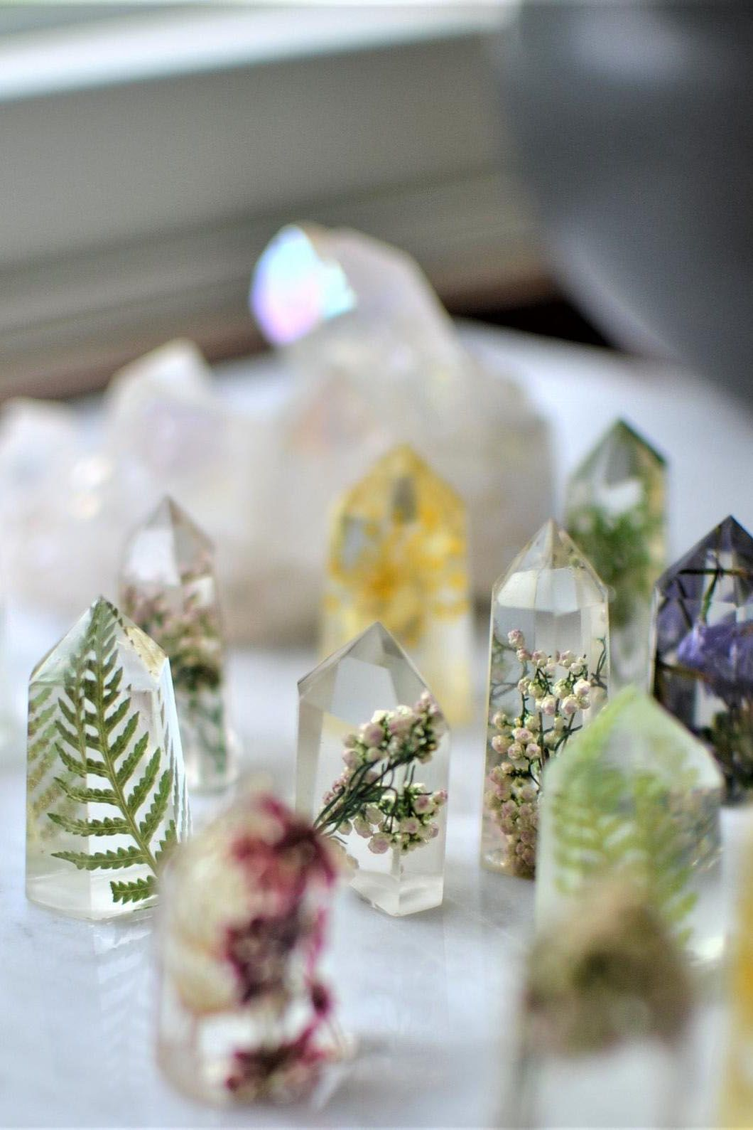 Tiny handmade resin crystal flowers, featuring preserved florals, moss, leaves, and feathers. Each one is less than two inches tall. Add to your desk for a piece of the outdoors inside.