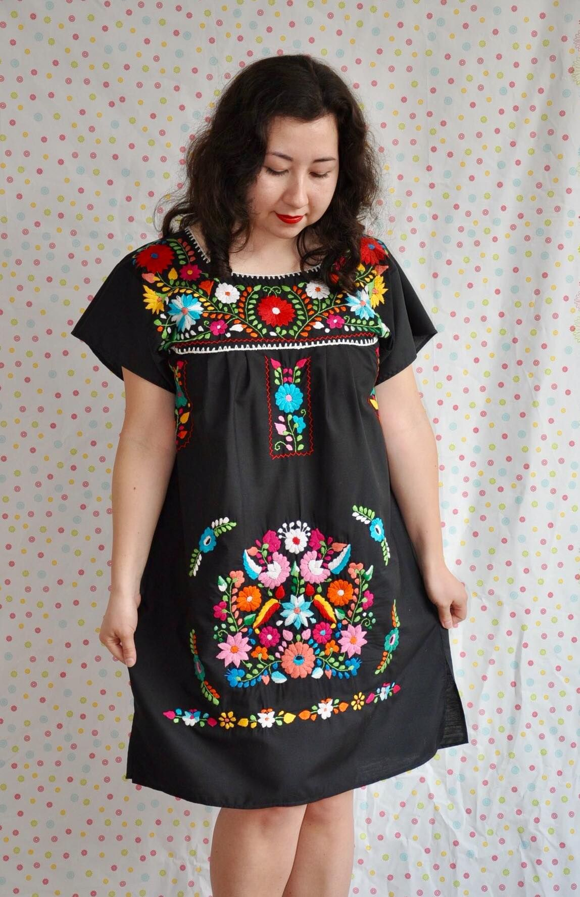 4cd847fe7762f This dress is originally from the Mexican State of Puebla. It is hand  embroidered with floral elements in different colors.