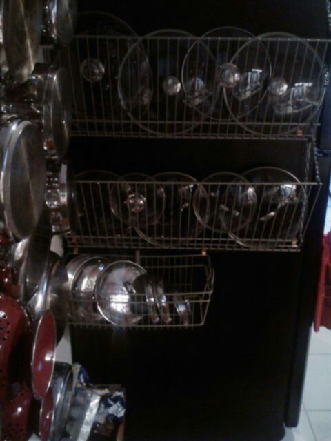 Pots and Pans -out of storage space and tired of trying to locate all your pots, pans and lids. Heres a crafty solution.