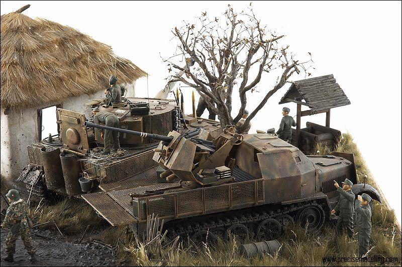 German Tiger tank, under repair and Flak Halftrack alert for the enemy.