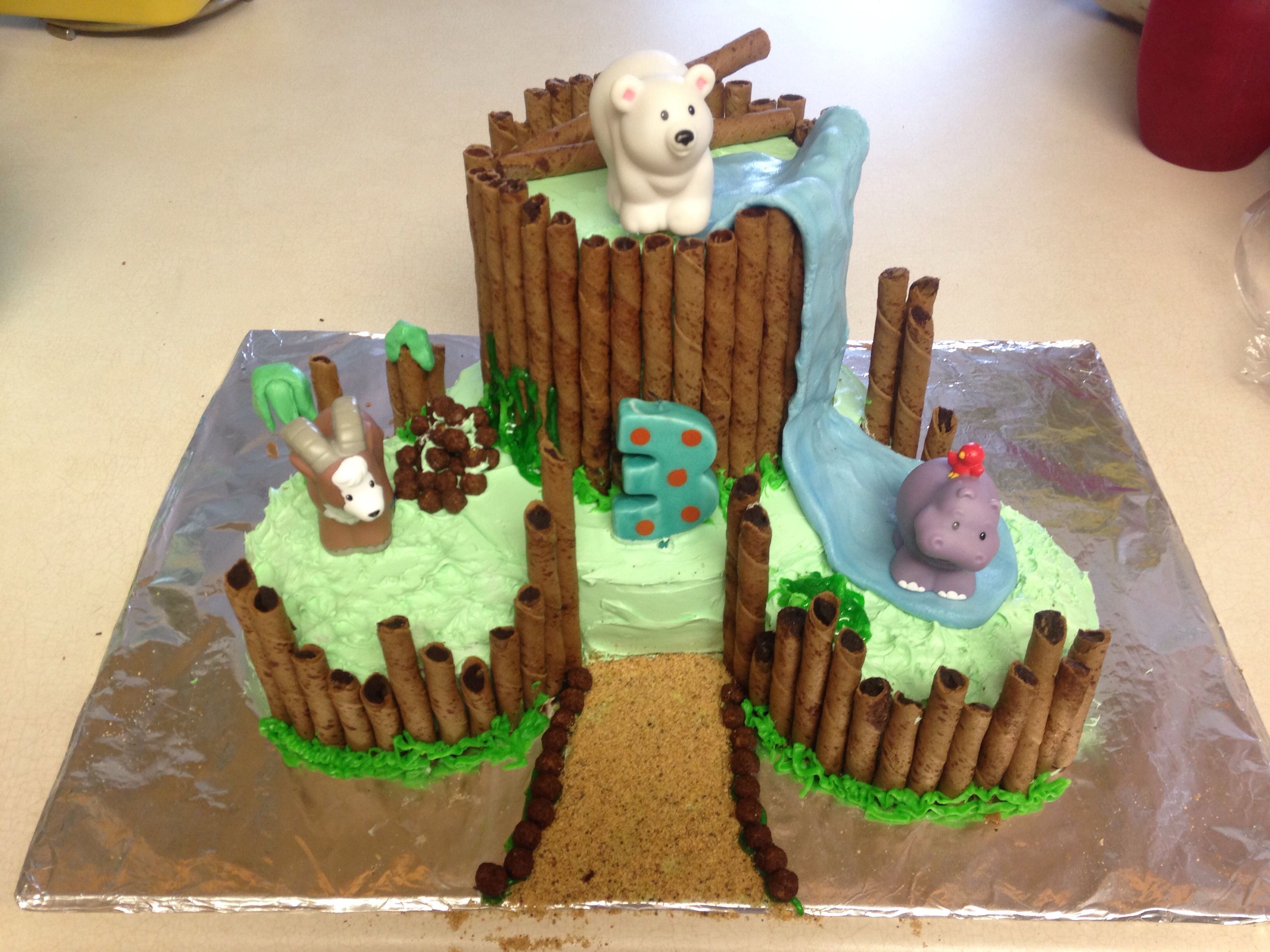 Zoo animal birthday cake Whipped frosting with a fondant waterfall