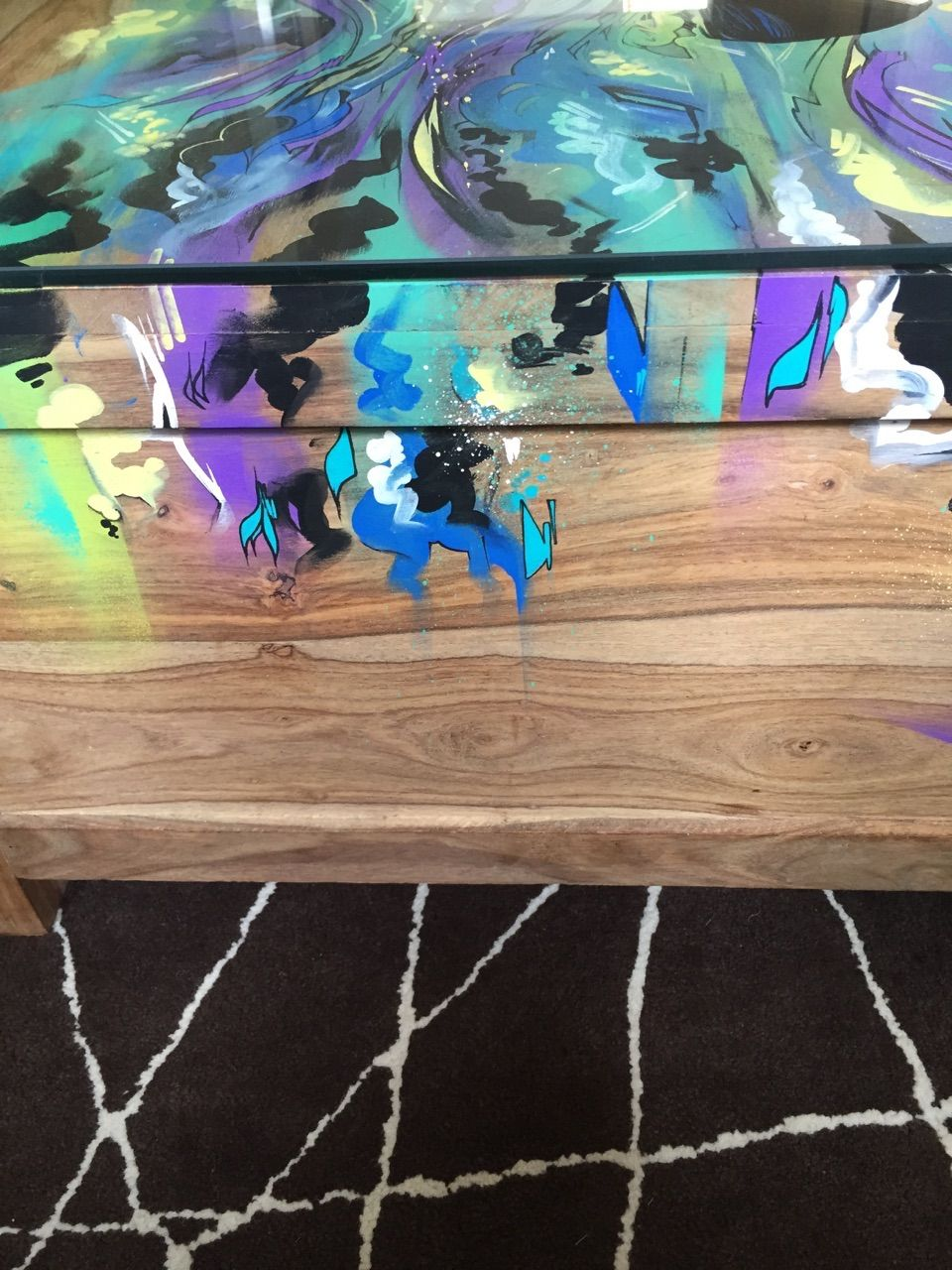 glass top coffee table with a twist of street art. coffee table