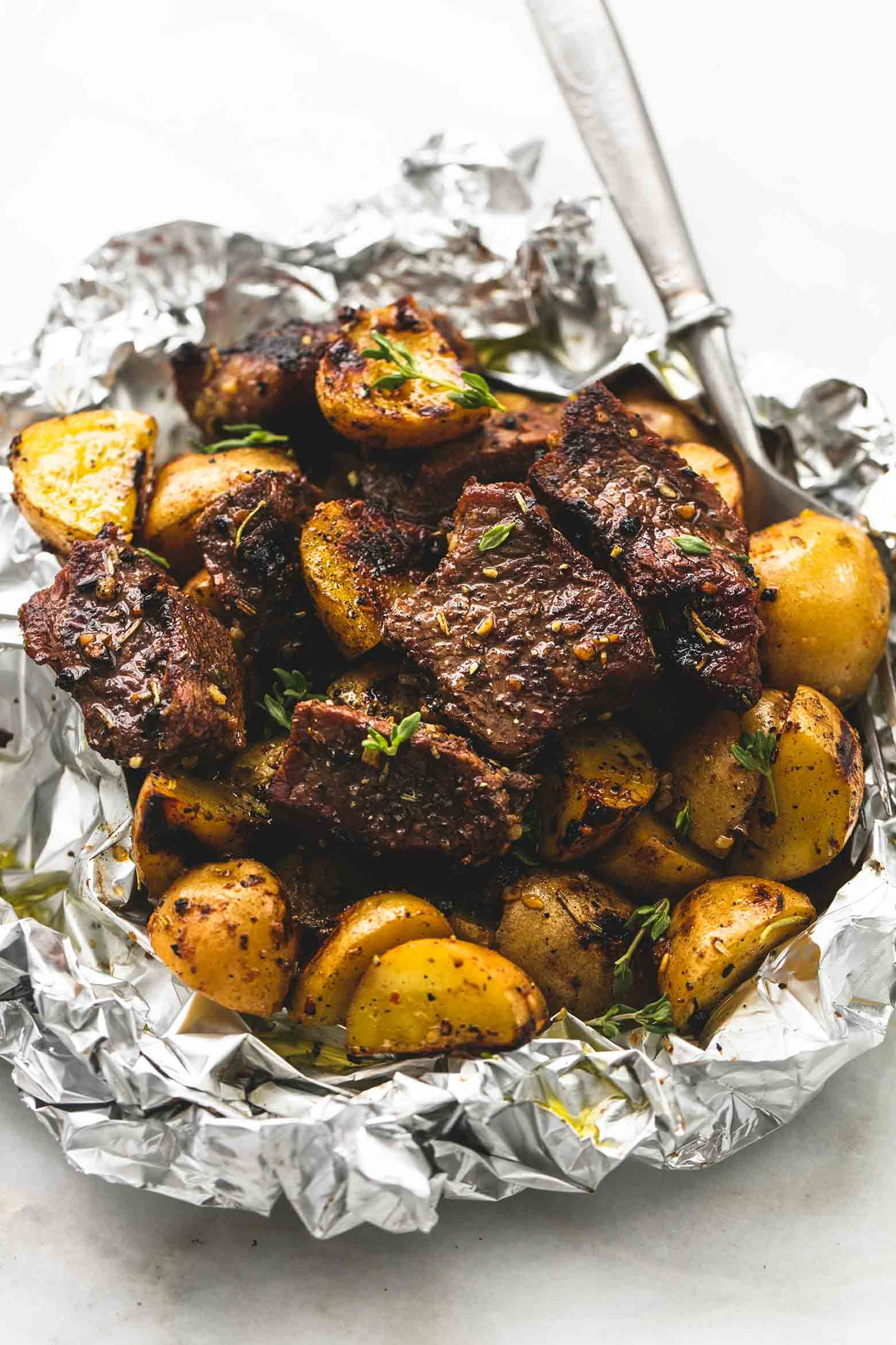 Juicy and savory seasoned garlic steak and potato foil packs are the perfect baked or grilled 30 minute hearty, healthy meal.  I am going to try 350