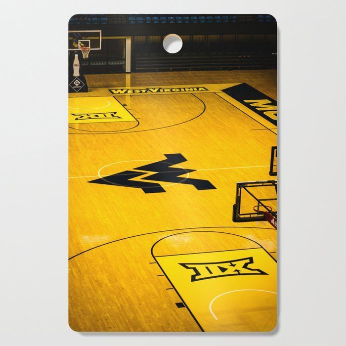 Awesome WVU Mountaineers Cutting Board. Our cutting boards feature bright, glossy designs that transform a kitchen essential into a functional style piece. Prep your food on the wood side, use the design side as a serving board and hang it up as kitchen wall art. Available in round or rectangle options.    - Round: 11.5