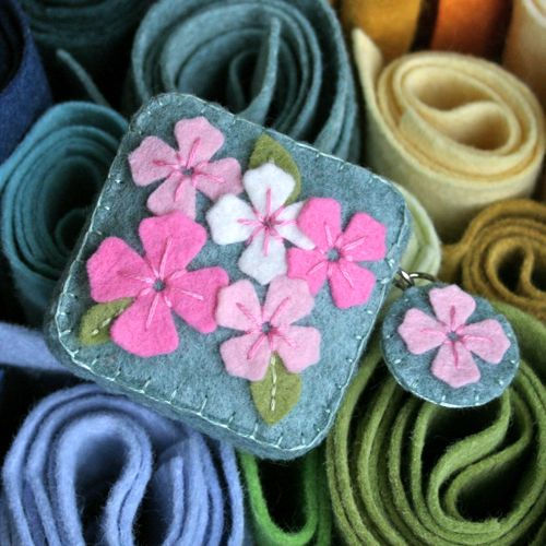 tape measure cover. nice embroidery touch on the flowers