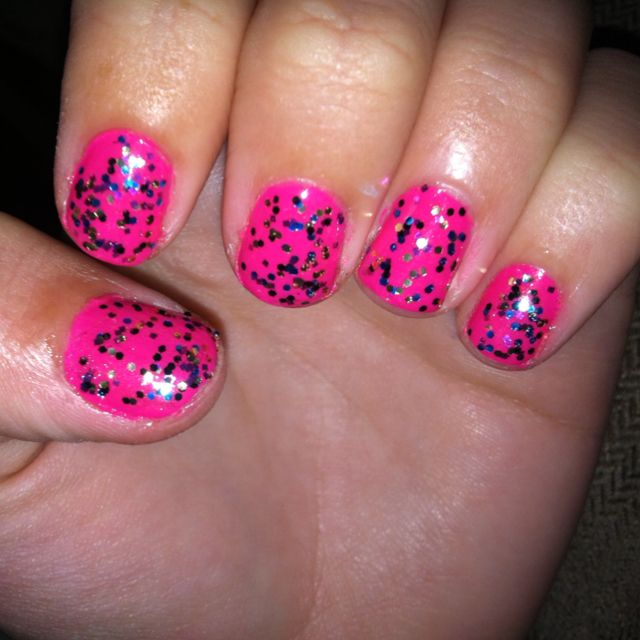 Hot pink, with blue, pink, black, and gold glitter specks. B E A utiful! :)