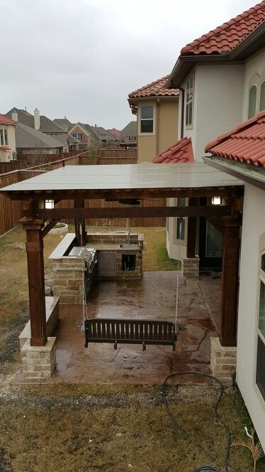 Complete Arbor Area With Bbq Grill And Sitting Bench Area For The