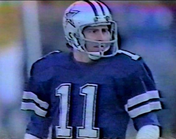 DANNY WHITE (11) strictly punted for the December 6, 1981