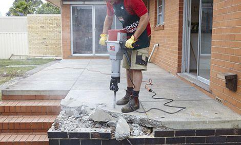 Breaking Concrete Slab Using A Jackhammer Concrete Slab Patio Concrete Slab Concrete Removal