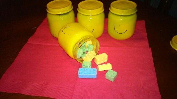 Lego party favors: minifigure head jars with candy bricks.  The birthday boy loved putting the faces on himself.
